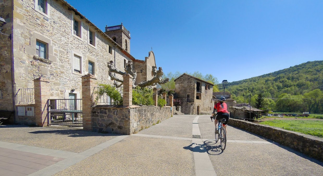 Cycling through a village near Girona in Catalonia
